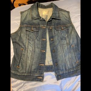 Women's blue denim sleeveless jean jacket